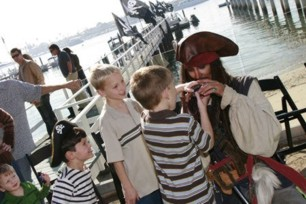 treasure hunt with Captain Parrot Jack a satirical parody of  Captain Jack  at a pirate theme children's birthday party