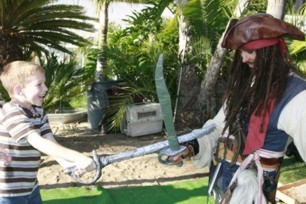 sword fighting game and sword training at a pirate theme birthday party