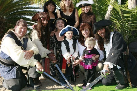 picture of a Deluxe pirate party with a Jack Sparrow impersonator and kids dressed as pirates