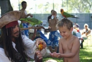 parrot show at a pirate theme children's birthday party with Captain Parrot Jack the childrens pirate party pirate entertainer