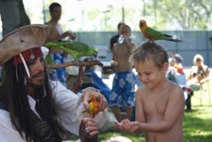 parrot show at a pirate theme children's birthday party with Jack