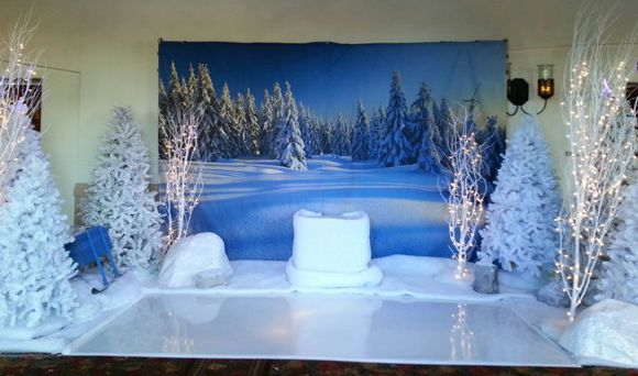 snow scene event decoration with simulated ice floor and artificial snow.